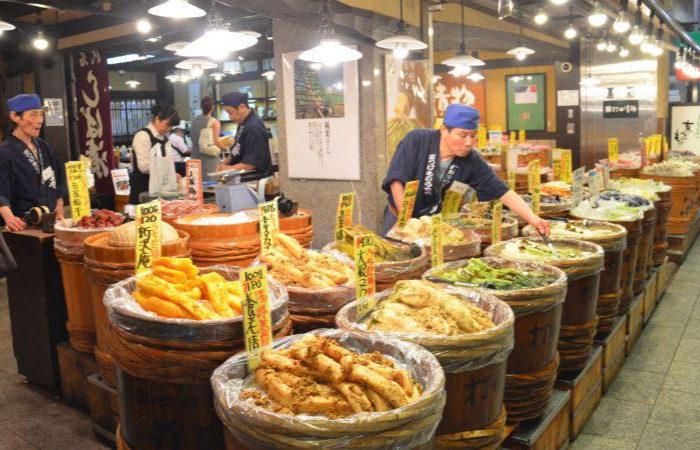 Many tubs of tsukuemono pickles on sale in Nishiki Market you can see yourself while in one of the best Kyoto food tours