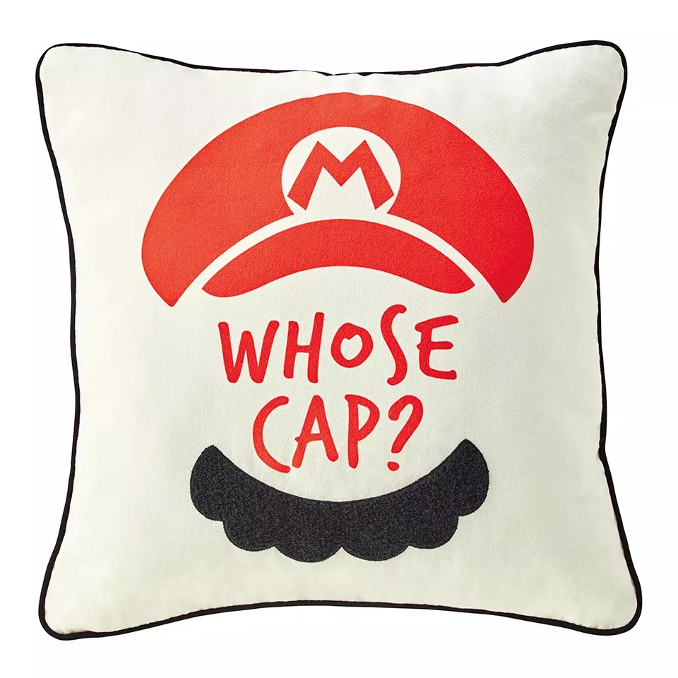 """Cushion with Mario's hat and moustache and the quote, """"Whose cap?"""""""