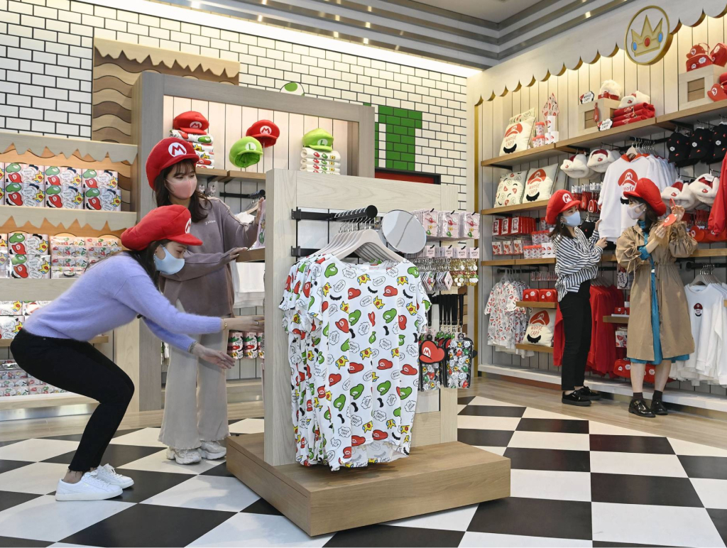 The Mario shop with customers wearing Mario hats