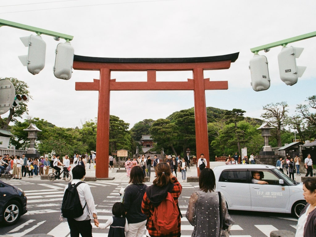 People waiting to cross the road in Japan