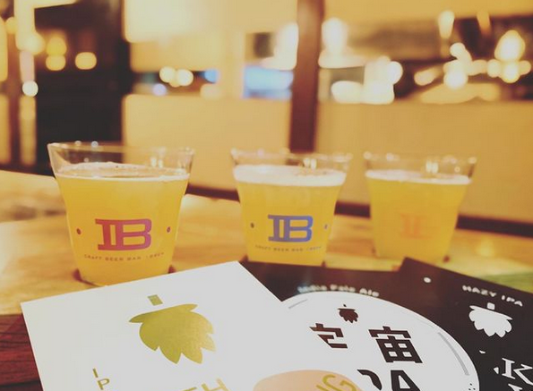 iBrew glasses filled with beer on a table.