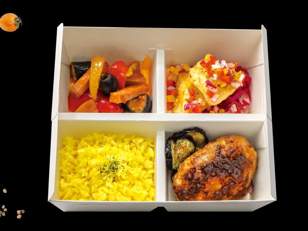 Image of Dinema Bento B with vegetable frittata, tempura, hambagu and vegetables