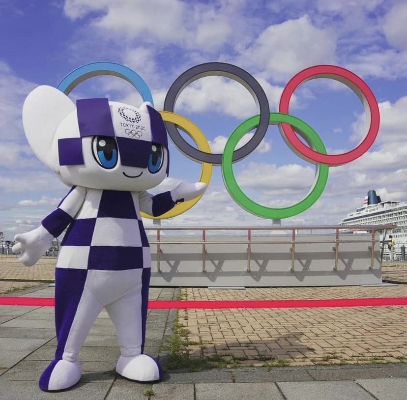 The Olympic mascot in front of the Olympic rings in Yokohama, Japan.